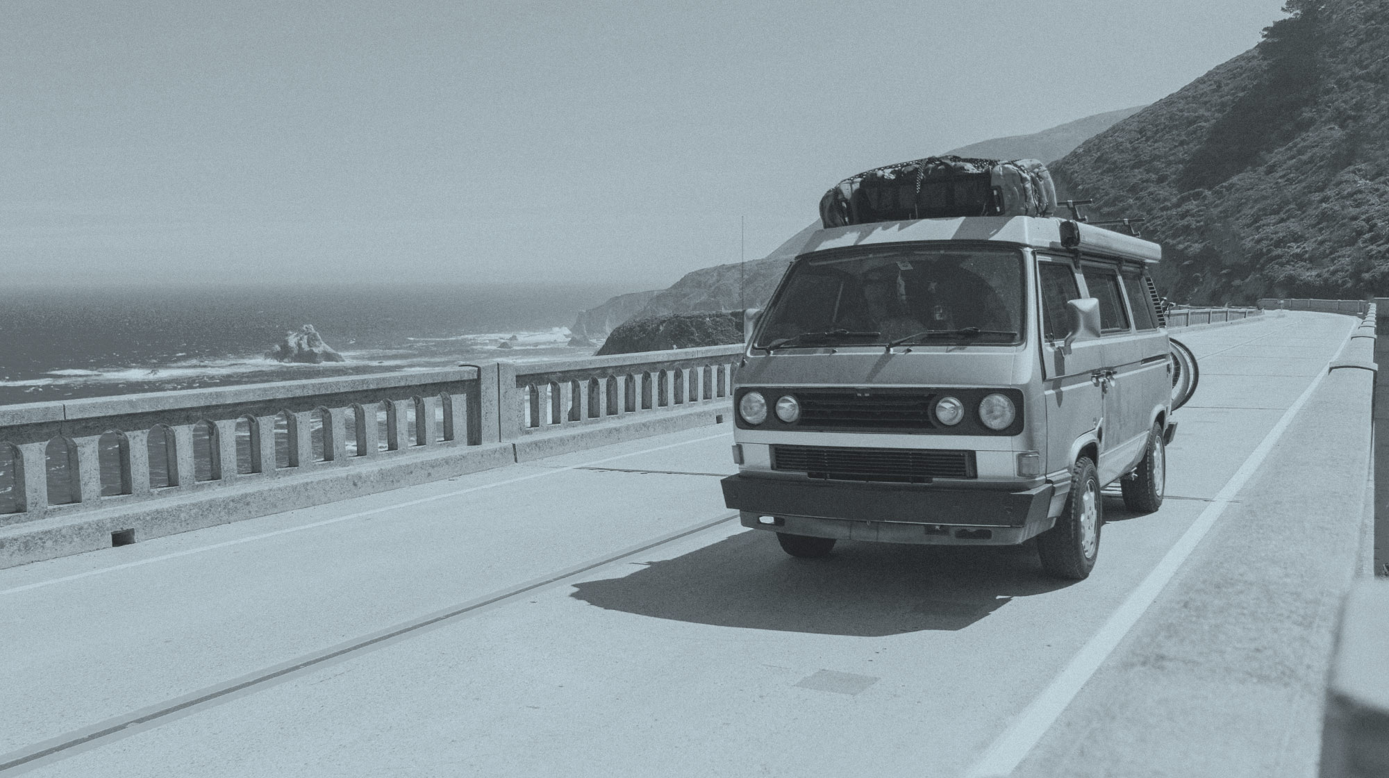 Vehicle driving along coastal highway.